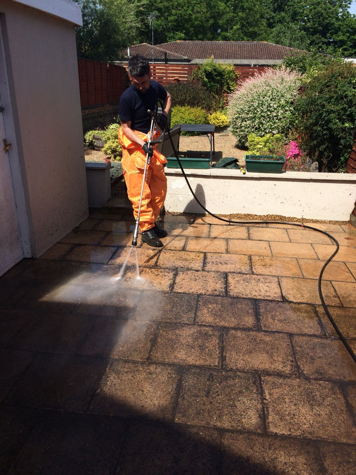One of our team jet cleaning a clients patio.