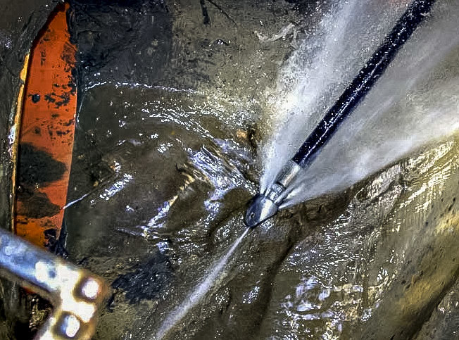 Our jetting equipment clearing a clients waste pipe.